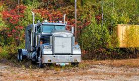 Powerful truck surrounded by foliage trees, New England.  Stock Photos