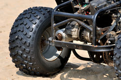 Powerful tyre of beach sand motorcycle. A motorcycle on beach sand with powerful tyre, shown as beach sand sport and entertainment, or featured vehicle Royalty Free Stock Photography