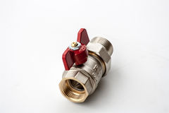 Powerful valve. Red valve isolated on the white background Stock Images