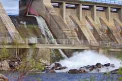 Powerful water discharge through gate of power plant Stock Photo