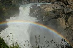 Rainbow over powerful waterfall in Chile stock photography