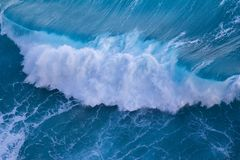 Powerful wave. Aerial view of powerful wave breaking near shore Royalty Free Stock Photo