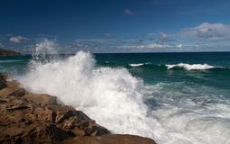 Powerful wave spray. The power of waves crashing against the rocks royalty free stock images