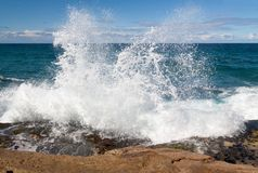 Powerful wave spray. The power of waves crashing against the rocks stock images