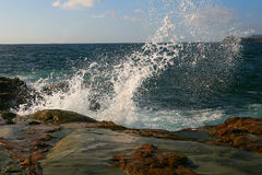 Powerful wave spray. The power of waves crashing against the rocks stock image