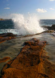 Powerful wave spray. The power of waves crashing against the rocks stock photos