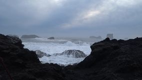 Powerful waves at black sand beach in Iceland 4k stock video