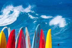 Powerful waves break at Lumahai Beach, Kauai with Surfboards Stock Image