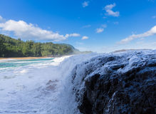 Powerful waves flow over rocks at Lumahai Beach, Kauai Royalty Free Stock Images