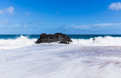 Powerful waves flow over rocks at Lumahai Beach, Kauai Royalty Free Stock Photo