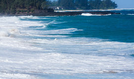 Powerful waves flow over rocks at Lumahai Beach, Kauai Royalty Free Stock Photography