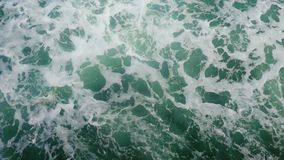 Powerful waves pulled out from fast moving boat, a huge stream of deep blue water with white foam rising up. 3840x2160 stock footage