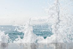 Powerful waves of the sea foaming, breaking against the rocky shore. sea textured. Athens, Greece stock photography