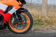 A powerful wheel of the orange bike royalty free stock photo