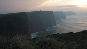 Powerful winds at sunset in Cliffs of Moher stock footage