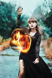 Powerful witch with fireball in hands Stock Photos