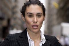Powerful woman. Horizontal portrait of an Hispanic, Latino business woman in an outdoor urban setting stock photo