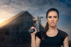 Powerful Woman Holding Gun Action Movie Style Royalty Free Stock Images