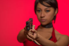 Powerful Woman Holding Gun Action Movie Style resident evil cosplay costume.  royalty free stock images