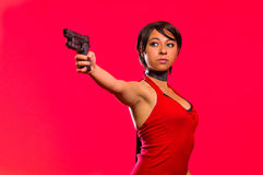 Powerful Woman Holding a gun, resident evil cosplay costume Stock Photos