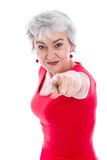 Powerful woman in red isolated with gray hair pointing with fing Royalty Free Stock Photos