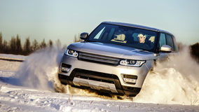 Powerful 4x4 offroader car running on snow field Royalty Free Stock Photos