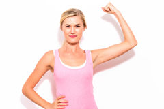Powerful young fit woman. On a white background Stock Photography