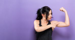 Powerful young fit woman. On a solid background Stock Image