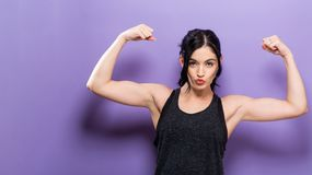 Powerful young fit woman. On a solid background Stock Photos