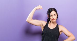 Powerful young fit woman. On a solid background Royalty Free Stock Photo