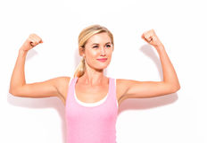 Powerful young fit woman. On a white background Stock Photo