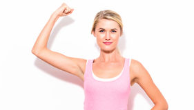 Powerful young fit woman. On a white background Royalty Free Stock Images