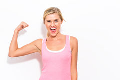 Powerful young fit woman. On a white background Royalty Free Stock Photos