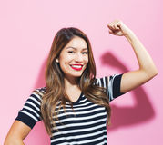 Powerful young woman. On a pink background Stock Photo