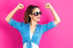 Powerful young woman. On a pink background Royalty Free Stock Photo