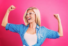 Powerful young woman. On a pink background Royalty Free Stock Photos