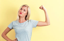 Powerful young woman. On a yellow background Stock Images
