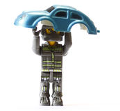 Powerfull. Toy robot holding a car Royalty Free Stock Images
