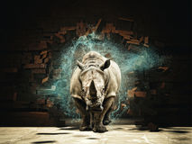Powerfull as rhino. Rhino destroy brick wall 3d rendering image stock photography