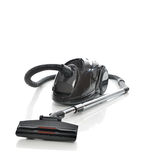 Powerfull black Vacuum cleaner on the floor isolated Royalty Free Stock Image