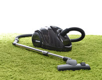 Free Powerfull Black Vacuum Cleaner On Green Carpet Floor Stock Photography - 48957092
