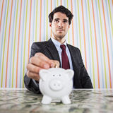 Powerfull businessman making savings Royalty Free Stock Image