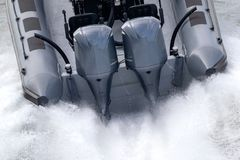 outboard motors on a speed boat stock photography