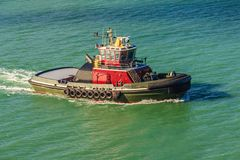 A powerfull tugboat on turcoise waters Royalty Free Stock Photos