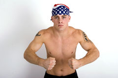 Powerhouse. Barechested, muscular man wearing a do=rag and holding a hard hat Stock Photos