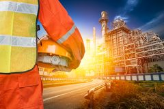 Powerhouse govern engineer. Govern engineer in safety uniform holding the helmet at powerhouse exterior building Royalty Free Stock Photo