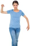 Powerless brunette in jeans and tshirt. On white background Stock Photography