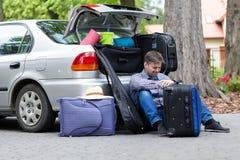 Powerless father next to car trunk. Horizontal Stock Photos