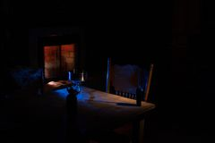 Powerless Night. Dark room with a few lights and the fireplace going Royalty Free Stock Photos