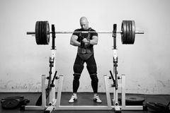 Powerlifter. With strong arms preparing to lift a heavy dumbbell Royalty Free Stock Photography